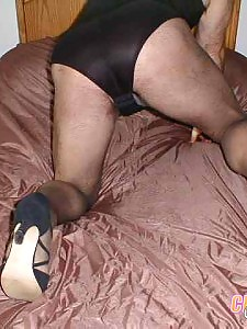 See this naughty cross dresser in a long slinky black dress